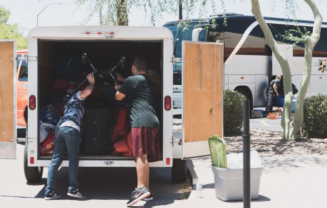 Two people loading a moving truck